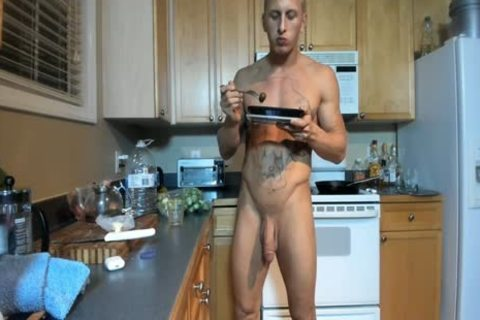 Hung brawny man Showing Off In The Kitchen